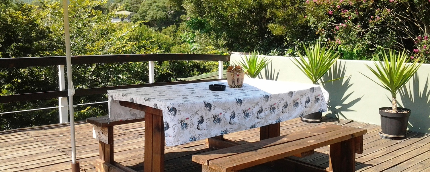 Spacious deck that offers a view of the valley and forestry mountains. Apartment B, Self Catering, Accommodation in Sabie